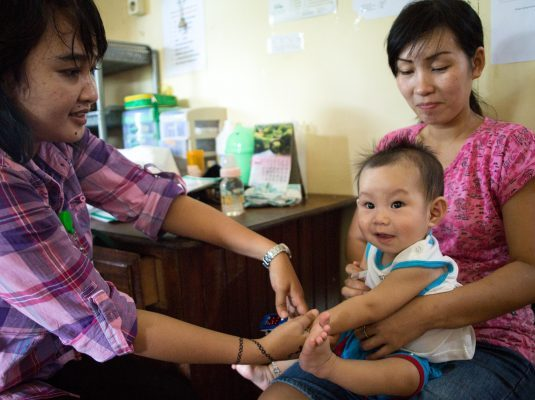 Treating an infant at ASRI Clinic