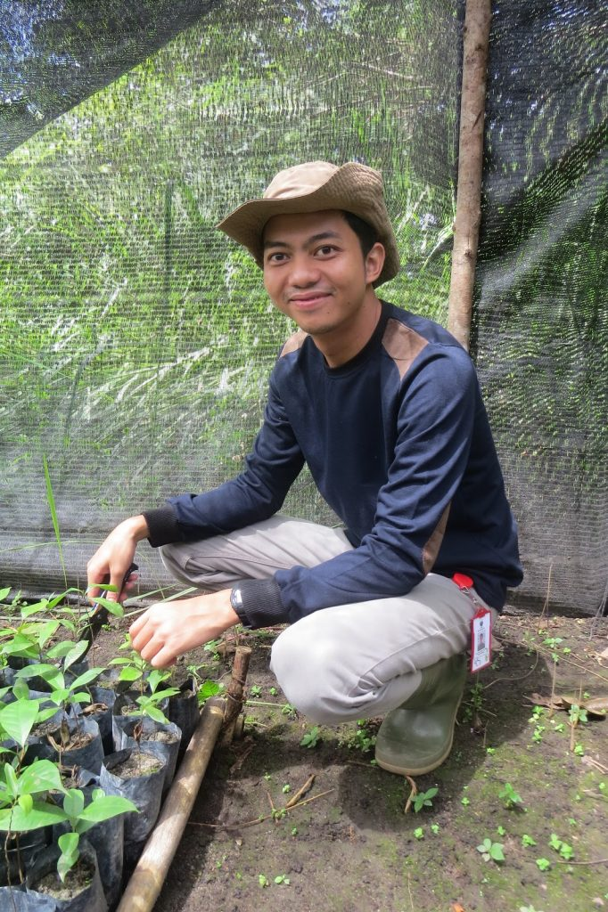 A man works to replant Borneo rain forests.