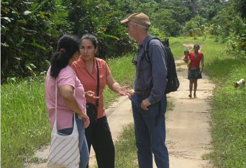 Sarah and Daniel talking with a community member in Suriname.