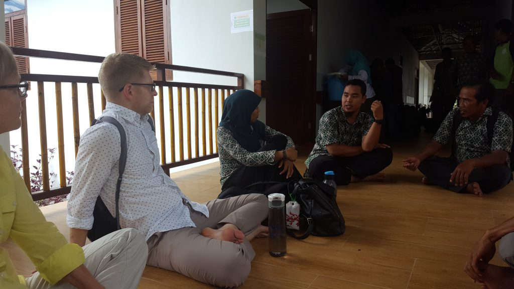 Travelers speak with former loggers about their work to protect Indonesian rain forests.