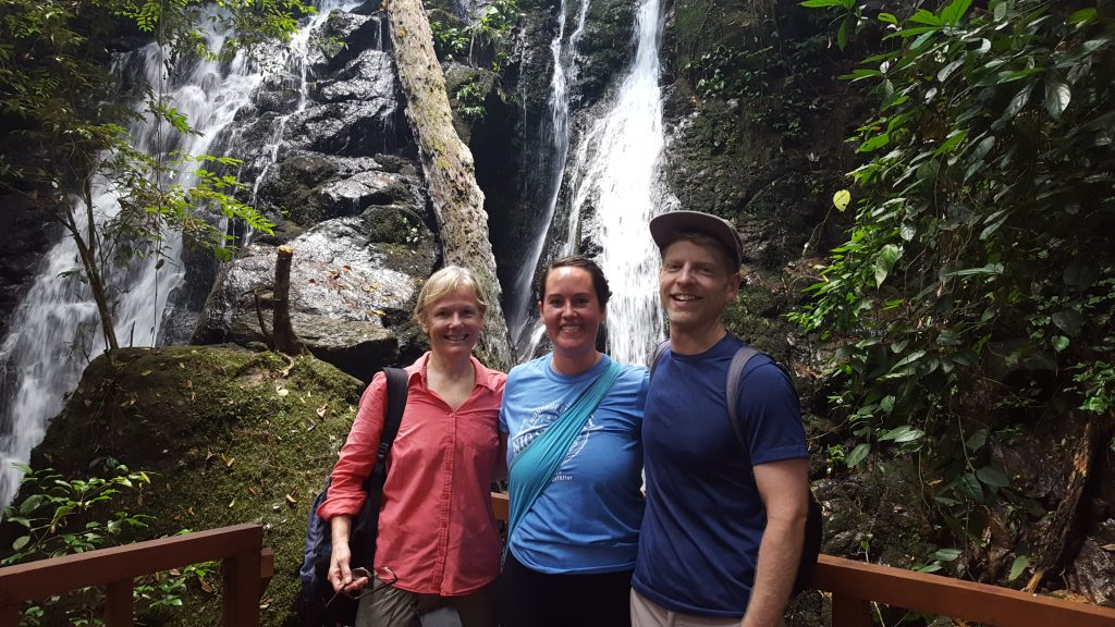 Travelers visit a waterfall in Gunung Palund Nation Park, Indonesia.